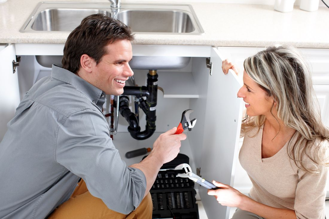 Picture of plumber helping woman