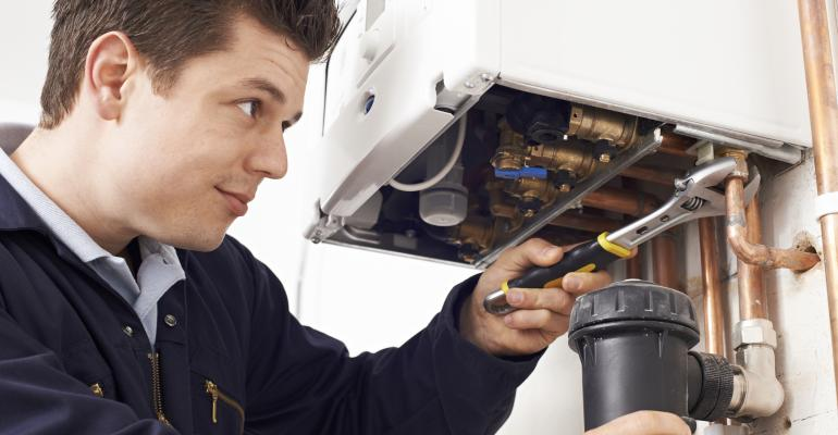 Picture of plumber working on water heater
